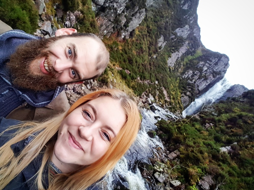 Jen and Hen at a waterfall in the Highlands - Travel Jobs - 5 Ways To See The World And Earn Money