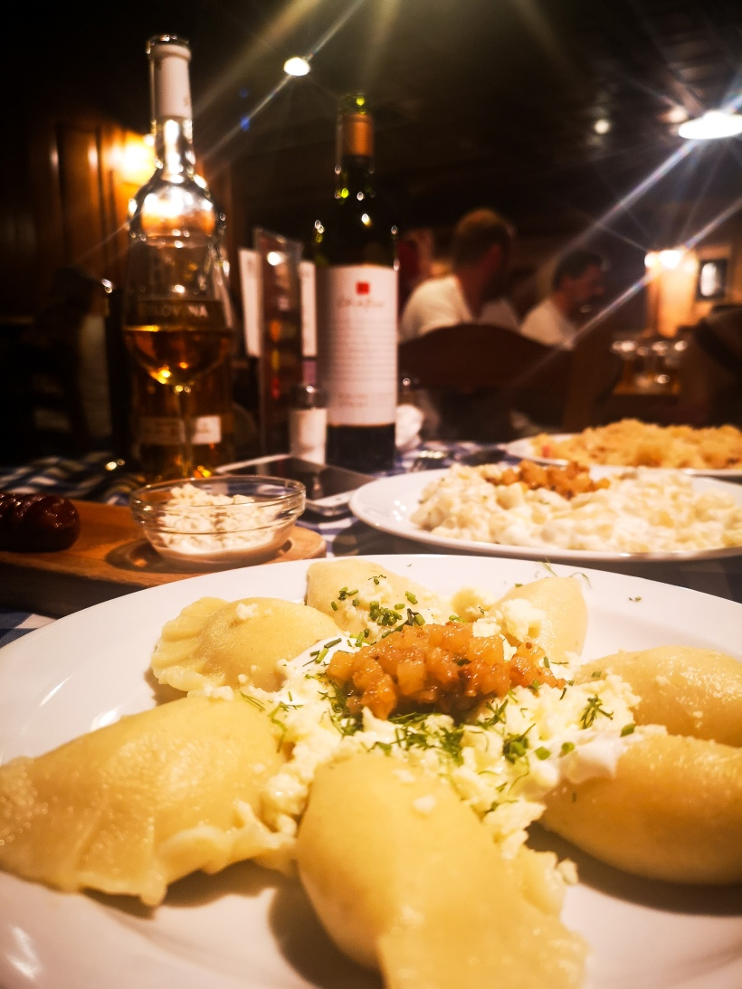 Dumplings on a plate and wine bottle