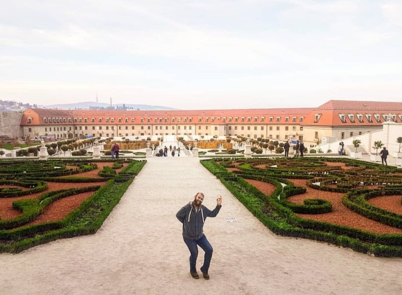 Henry in a large garden in front of a castle - One and Two Day Itineraries To Bratislava + First Timer's Guide: Written By Locals!